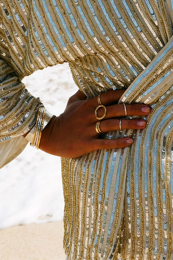 model wears gold molten circle cocktail ring