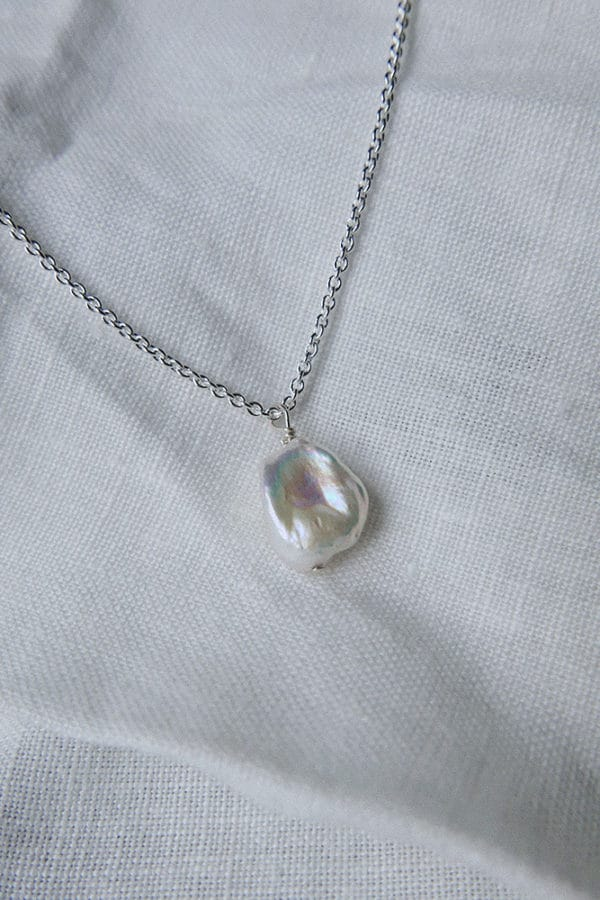 single baroque pearl pendant on silver chain